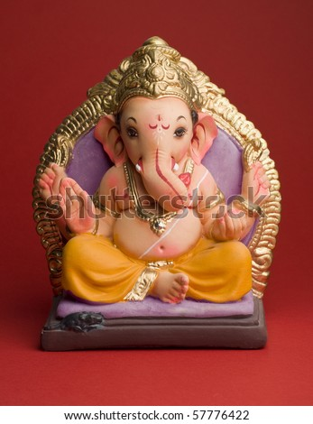 A clay statue of an Indian god Lord Ganesha. - stock photo
