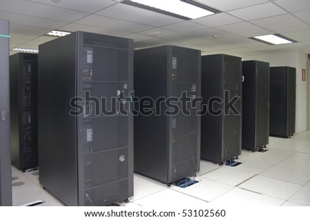 A clean and consistent row of server racks in a datacenter. - stock photo
