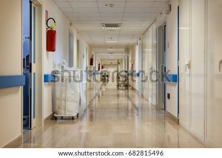 a clean and empty hospital corridor with nobody on sight