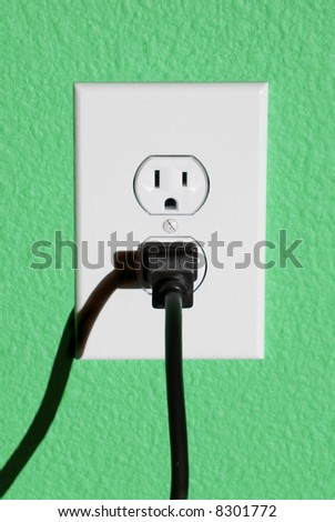 A clean image of a 110 volt wall power outlet against a freshly painted wall.  Perfect image for any abstract energy promotion use or to make inferences for home design or appliance use. - stock photo