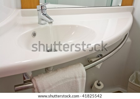 A clean white wash basin
