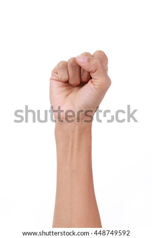 A clenched fist held high in protest.Punching fist on white background
