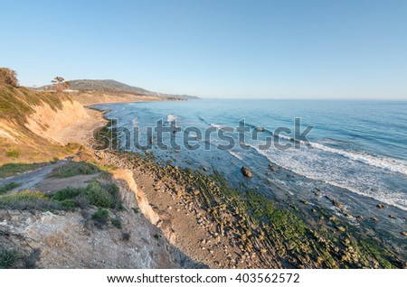 A cliff view of the Pacific ocean at low tide in Carpinteria, California.