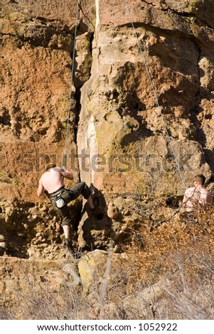 A climber descends down the face of a granite cliff in Castlewood Canyon in central Colorado