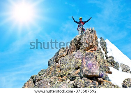A climber on the summit - stock photo