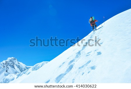 A climber reaching the summit of the mountain. Active sport concept