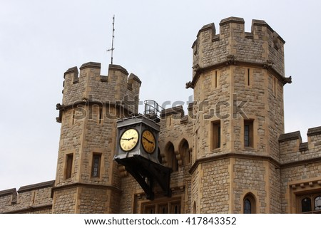 A Clock Adorning the Tower of London, Officially Her Majesty's Royal Palace and Fortress of the Tower of London, is a Historic Castle Located on the North Bank of the River Thames. - stock photo