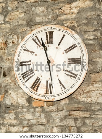 A clock in an old farmhouse in Tuscany. Even if they are old will stop working but he can not stop time. - stock photo