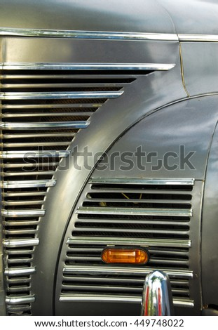 A close up abstract view of the front grill on an old scrap car - stock photo