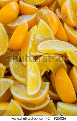 A close-up and selective focus sliced Oranges . Image has grain or blurry or noise and soft focus when view at full resolution. (Shallow DOF, slight motion blur) - stock photo