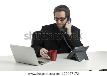 A close-up image of a busy businessman on his office while answering call and looking on his laptop