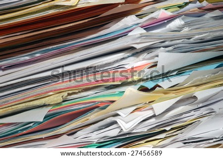 A close up image of a large stack of papers.
