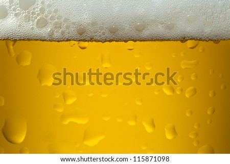 A close-up image of a yellow color beer into the glass