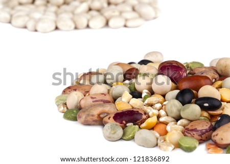 A close up image of assorted beans against white background - stock photo