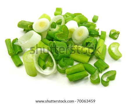 A close up image of chopped spring onions on a white background - stock photo