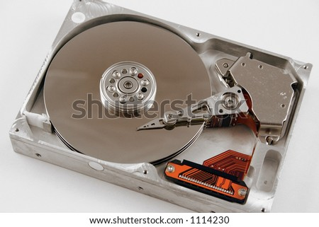 A close up macro of an opened computer harddrive. - stock photo