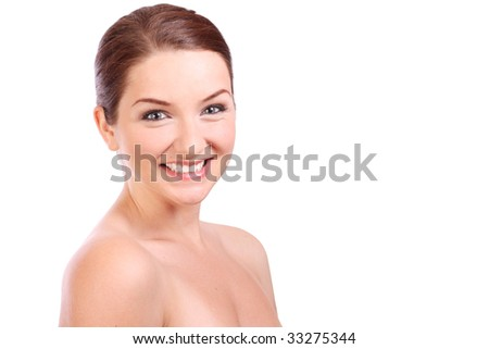 A close up of a beautiful brunette girl smiling and looking at the camera.