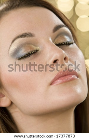 A close up of a beautiful model's make up