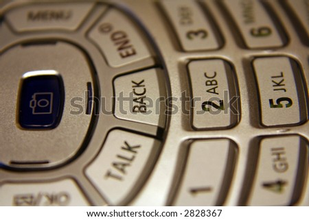 A close up of a cell phone keypad.