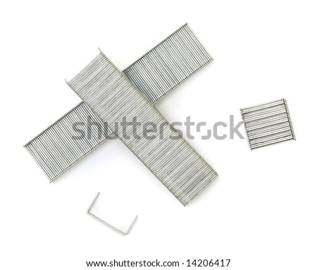 A close up of a collection of staples shot against a white background.