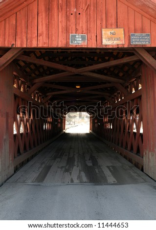 A close-up of a covered bridge in rural Vermont. - stock photo
