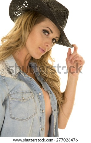 A close up of a cowgirl in her jean shirt and western hat.
