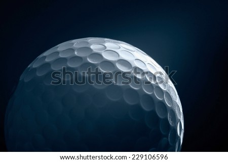 A close-up of a golf ball - stock photo