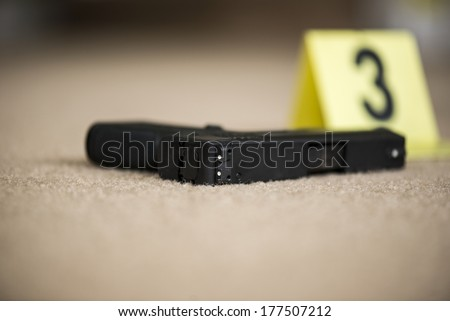 a close up of a gun at a crime scene - stock photo