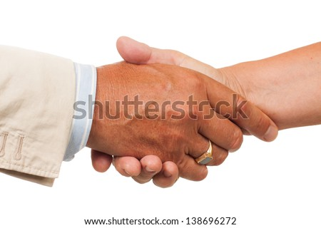 A close-up of a hand shake between a man and a woman. Isolated on white. - stock photo