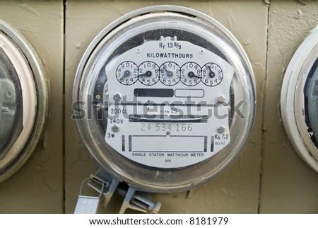 A close up of a kilowatt hour single stator power company meter. - stock photo