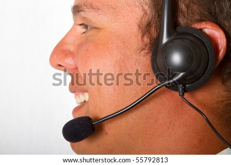 A close up of a man with a black head set on - stock photo