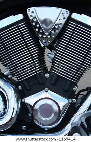 A close-up of a motorcycle engine with lots of chrome. - stock photo
