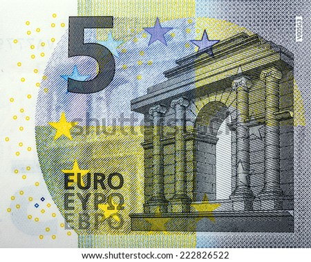 A close-up of a new 5 Euro bank note with added Germany V005G3 writing - stock photo