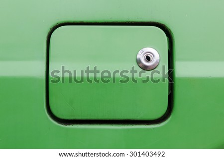 A close up of a petrol cap cover on a old car , Old oil tank cover - stock photo