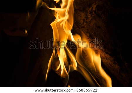 A close up of a piece of wood on fire - stock photo
