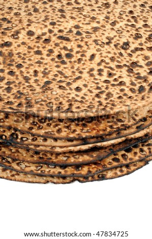 A close up of a pile of round matzo. - stock photo