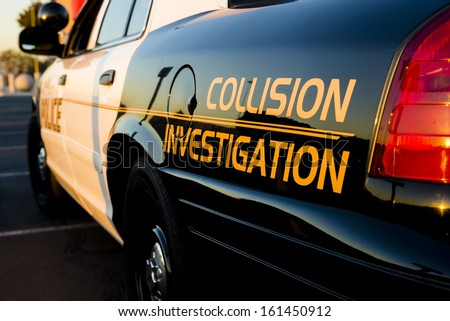 A close up of a police car that investigate traffic collisions. - stock photo