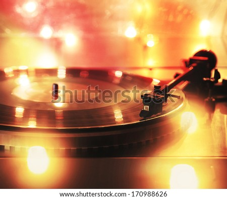 a close up of a record player with bokeh lights  - stock photo