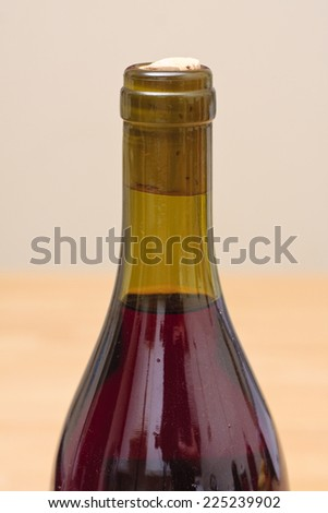 A close-up of a red wine bottle top and cork - stock photo