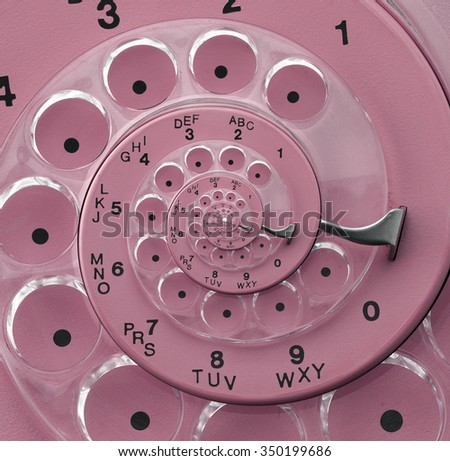 A close up of a rotary phone's dial
