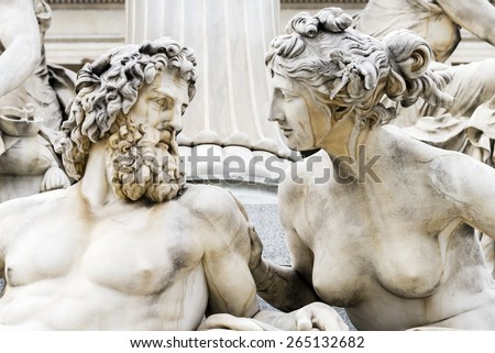 A close up of a sculpture of a man and women gazing into each others eyes. - stock photo