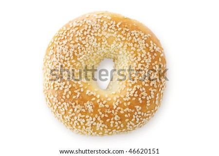 A close up of a sesame seed bagel, viewed from above. Isolated on white with a drop shadow. - stock photo