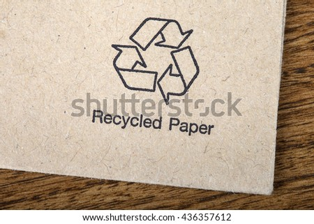 A close-up of a symbol indicating that the item is made from recycled paper. - stock photo