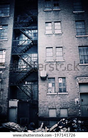A Close Up Of A Tall Brick Apartment Building.