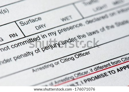 A close up of a traffic ticket.