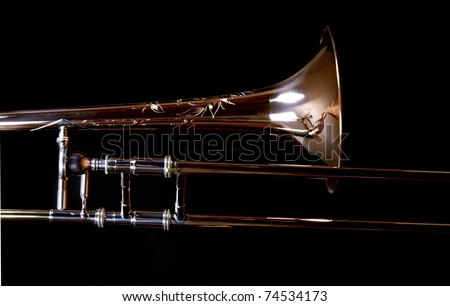A close up of a trombone, isolated on black - stock photo