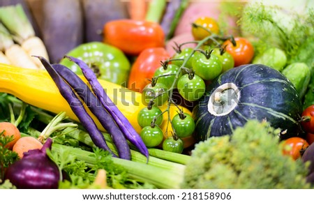 A close up of a variety of colorful organic vegetables at a farmers market.  - stock photo