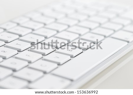 A close-up of a white computer keyboard on a white background - stock photo