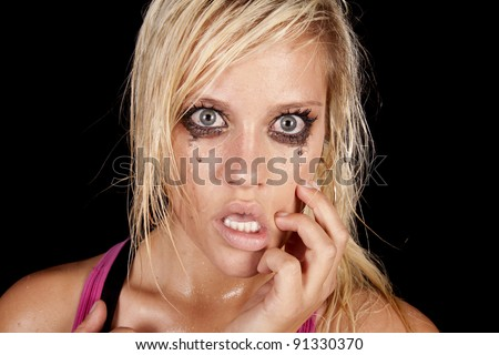 A close up of a woman that is crying and looks very unhappy and sad. - stock photo