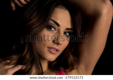 A close up of a woman with a sensual expression on her face. - stock photo